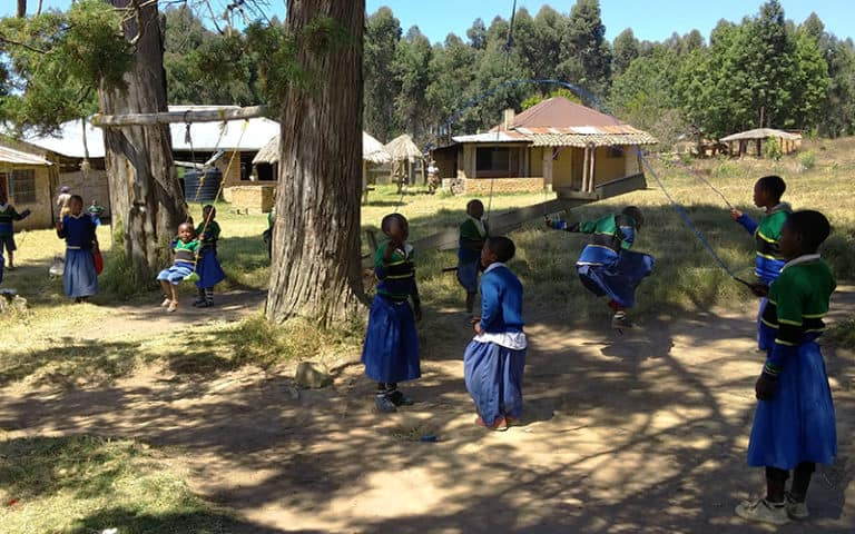 School children play in the yard during lunch.